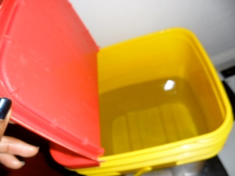 Create appropriate holes in a large watertight container, fill with water
